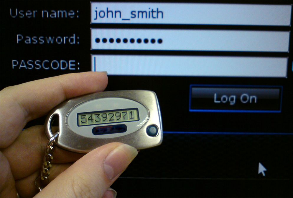 a person holding a two-factor authentication device